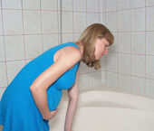 Toxicosis. The pregnant woman in a bathroom — Stock Photo