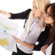 Two businesswoman looks on the graph — Stock Photo