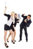 Two the business woman beat the man folders — Stock Photo