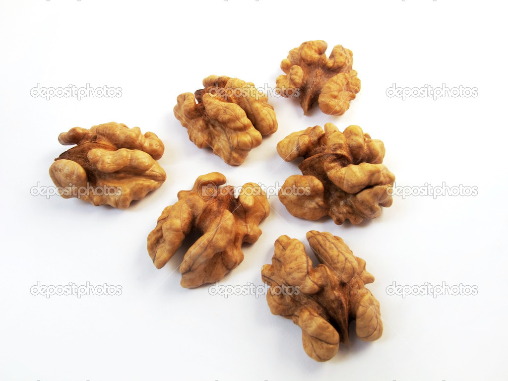 6 nuts are laid out in the form of a triangle on a white background — Stock Photo #5827759