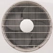 Fan uder white grate — Stock Photo