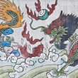 Dragon and fish painting on mable wall — Stock Photo