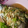 Spicy steamed fish with lemon — Stock Photo