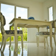 Stock Photo: Two chais and table in dining room