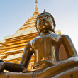 Buddha image with pagoda in background — Stock Photo