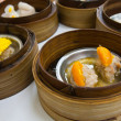 Dimsum in bamboo container — Stock Photo