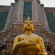Photo: Statue of Buddhholding monk's alms bowl
