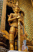 Golden Titan statue — Stock Photo