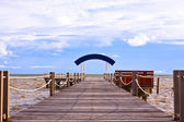 Wooden jetty into the sea — Stock Photo