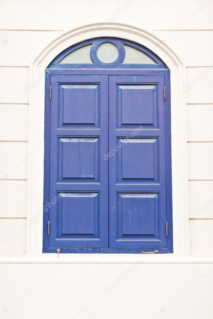Closed Vintage purple Thai style window on white wall — Stock Photo #6379275