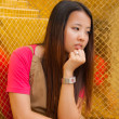 Stock Photo: Young Thai women distracted and rest her chin on hand