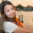 Young Thai woman smile in front of river — Stock Photo