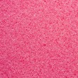 Pink sponge texture close up — Stok fotoğraf