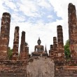 Stock Photo: Buddhstatue among pillars overall
