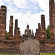 Stock Photo: Buddhstatue among pillars vertical overall