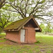 Brick hut in park tilted — Stock Photo #6387157