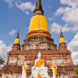Buddha statue and ruin pagoda in park in Ayutthaya — Stock Photo