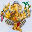 Photo: Golden six hands ganeshon white wall
