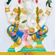 Stock Photo: White ganeshblue dresses
