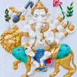 Stock Photo: Eight hands ganeshriding lion