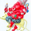 Red ganesha riding rat — Stock Photo