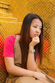Young Thai women distracted and rest her chin on hand — Stock Photo
