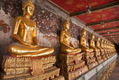 Buddha statue in a row tiled from right — Stock Photo