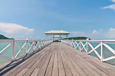 White bridge in to the sea with blue sky — Stock Photo