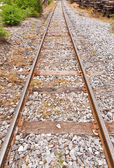 Train rail in vertical endless — Stock Photo