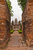 Set of three pagodas behind wall in sukhothai top — Stock Photo