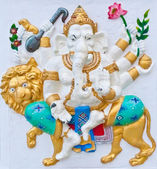 Eight hands ganesha riding lion — Stock Photo