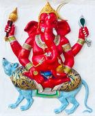 Red ganesha riding blue rat — Stock Photo