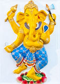Golden ganesha standing on lotus — Stock Photo