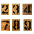 Set of black number on wood — Stock Photo