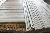 Flat metal bar stack in group — Stock Photo
