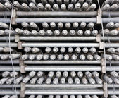 Many layers of machine bolts vertical — Stock Photo