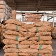 Brown sacks stack on pallet — Stock Photo #6590685