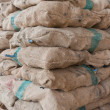 Stock Photo: Pile of sacks tilted