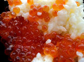 Rice with red caviar in black chalice — Foto de Stock