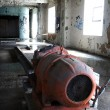 Orange machine inside abandoned brewery — 图库照片