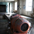 Orange machine inside abandoned brewery — Stock Photo