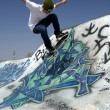 Skateboarder doing trick on ramp — Stock Photo