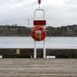 Lifesaver Floatation device on end of dock — Stock Photo