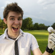 Young man excited about golf — Stock Photo