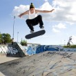 Stock Photo: Skateboarder Doing flip on ramp