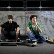 Skateboarders sitting in skatepark — Stock Photo