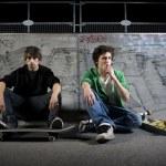 Skateboarders sitting in skatepark — Stock Photo #5852331