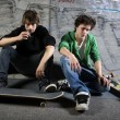 Two skateboarders sitting on ramp — Stock Photo