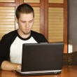 Young male studying on laptop — Stock Photo