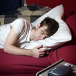 Young man sleeping in bed — Stock Photo #5852418